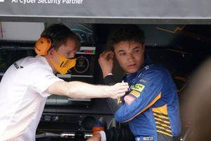 Lando Norris, McLaren, on the pit wall