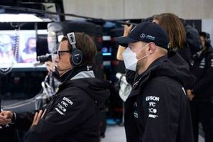 Toto Wolff, Team Principal and CEO, Mercedes AMG, and Valtteri Bottas, Mercedes, in the garage