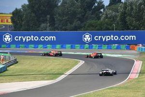 Max Verstappen, Red Bull Racing RB16B, Carlos Sainz Jr., Ferrari SF21, and Nikita Mazepin, Haas VF-21