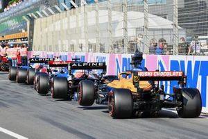 Esteban Ocon, Alpine A521, Antonio Giovinazzi, Alfa Romeo Racing C41, Fernando Alonso, Alpine A521, and Daniel Ricciardo, McLaren MCL35M, queued to enter Parc Ferme after Qualifying