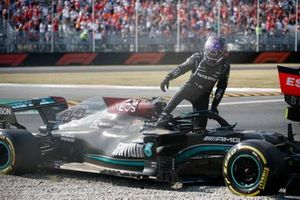 Lewis Hamilton, Mercedes, climbs out of his car after crashing out with Max Verstappen, Red Bull Racing