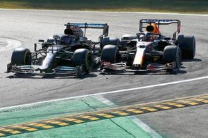 Lewis Hamilton, Mercedes W12, and Max Verstappen, Red Bull Racing RB16B, crash