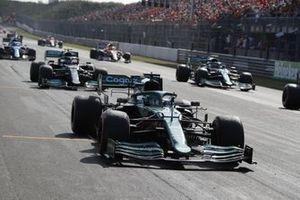Lance Stroll, Aston Martin AMR21, Sebastian Vettel, Aston Martin AMR21, and Valtteri Bottas, Mercedes W12, on the grid at the end of FP2