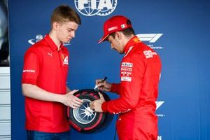 Charles Leclerc, Ferrari, celebrates pole position, and receives his Pirelli pole trophy from Robert Shwartzman, PREMA Racing