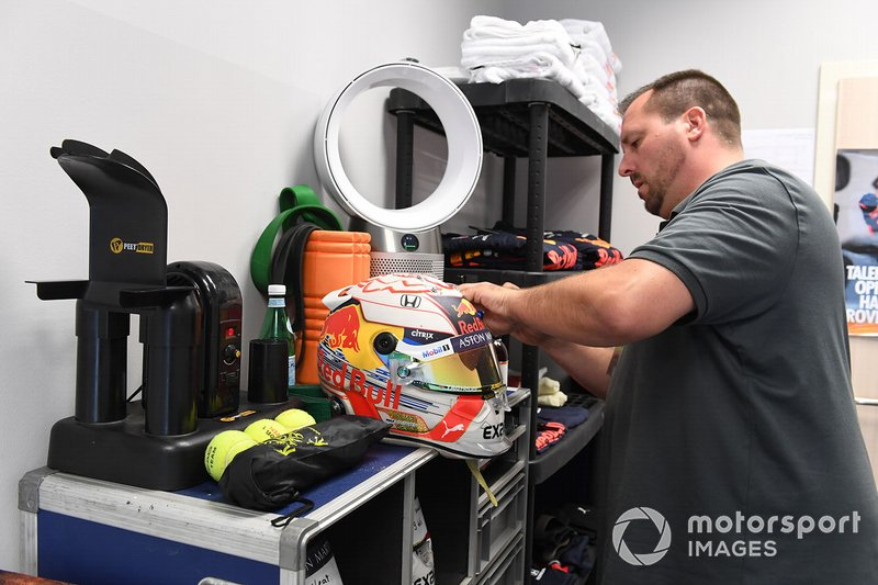 A Schuberth helmet engineer works on the helmet of Max Verstappen, Red Bull Racing