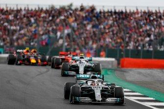 Lewis Hamilton, Mercedes AMG F1 W10, leads Valtteri Bottas, Mercedes AMG W10, Sebastian Vettel, Ferrari SF90, and Pierre Gasly, Red Bull Racing RB15