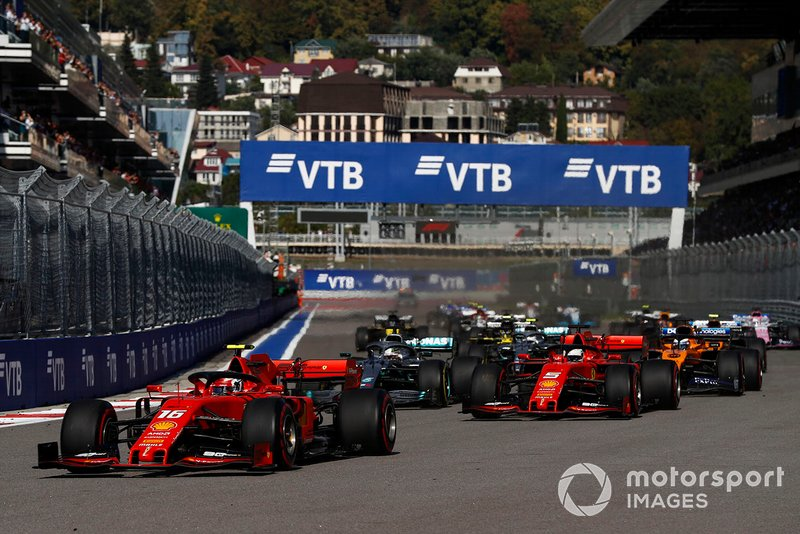 Charles Leclerc, Ferrari SF90, leads Sebastian Vettel, Ferrari SF90 at the start