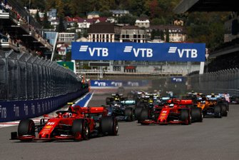 Charles Leclerc, Ferrari SF90, leads Sebastian Vettel, Ferrari SF90, Lewis Hamilton, Mercedes AMG F1 W10, Carlos Sainz Jr., McLaren MCL34, Valtteri Bottas, Mercedes AMG W10, and the rest of the field at the start