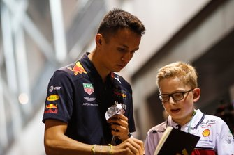 Alexander Albon, Red Bull Racing, signs an autograph for a young fan