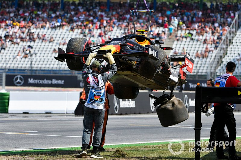 Marshals deal with the damaged car of Pierre Gasly, Red Bull Racing RB15