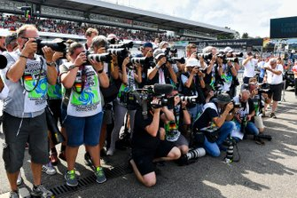 A pack of photographers take aim at pole man Lewis Hamilton, Mercedes AMG F1