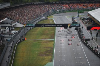 Lewis Hamilton, Mercedes AMG F1 W10, leads Valtteri Bottas, Mercedes AMG W10, Max Verstappen, Red Bull Racing RB15, Carlos Sainz Jr., McLaren MCL34, Kimi Raikkonen, Alfa Romeo Racing C38, and the rest of the field at the start