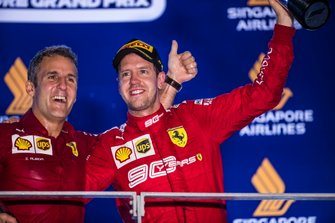 I-aki Rueda, Head of Strategy, Ferrari, and Sebastian Vettel, Ferrari, 1st position, on the podium