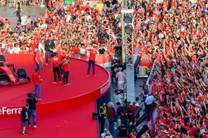 The Ferrari Academy drivers take photos from the stage