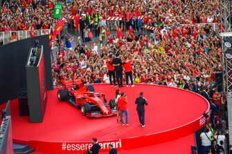 Charles Leclerc, Ferrari, Mattia Binotto, and Sebastian Vettel, Ferrari stand on the stage in front of the crowd