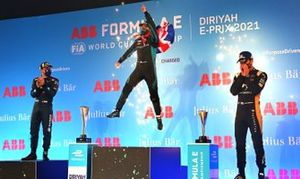 Sam Bird, Panasonic Jaguar Racing, 1st position, leaps in the air in celebration on the podium