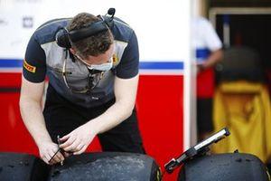 A Pirelli technician takes some data readings