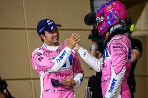 Sergio Perez, Racing Point, 1st position, and Lance Stroll, Racing Point, 3rd position, celebrate in Parc Ferme