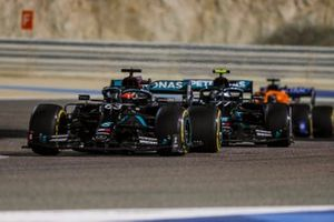 George Russell, Mercedes F1 W11 and Valtteri Bottas, Mercedes F1 W11 battle
