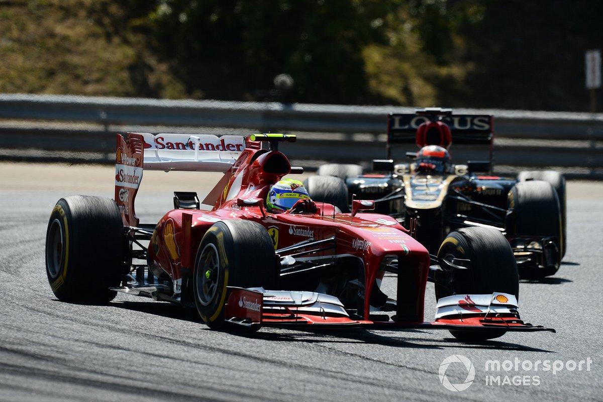 Felipe Massa, Ferrari F138 y Romain Grosjean, Lotus E21