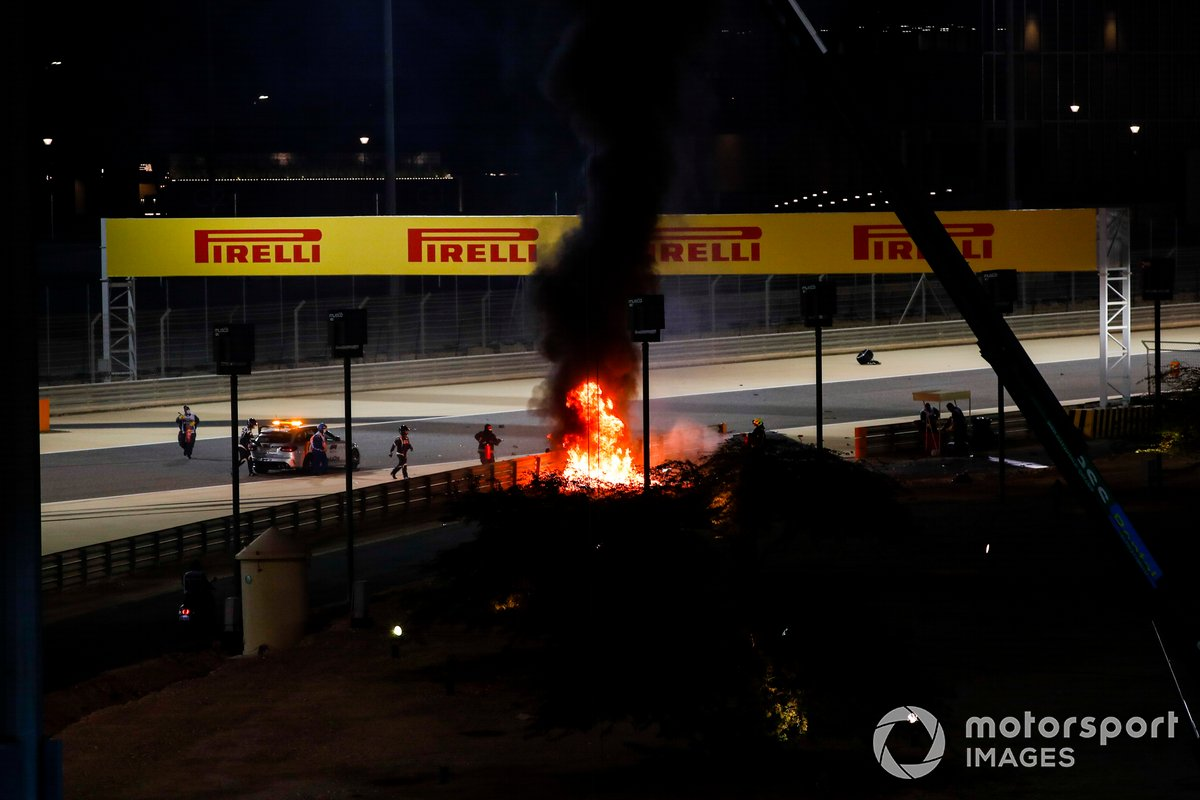 The crashed car of Romain Grosjean, Haas VF-20 on fire