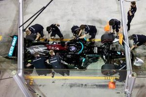 Lewis Hamilton, Mercedes W12, in the pits with mechanics