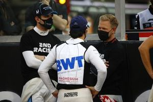 Nicholas Latifi, Williams Racing, Sergio Perez, Racing Point, and Kevin Magnussen, Haas F1, on the grid