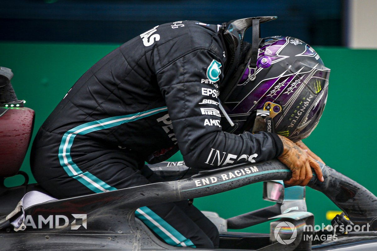 Lewis Hamilton, Mercedes-AMG F1, 1st position, arrives in Parc Ferme after securing his 7th world drivers championship title Lewis Hamilton, Mercedes-AMG F1, climbs out of his car after winning the race, to take his 7th World Championship title