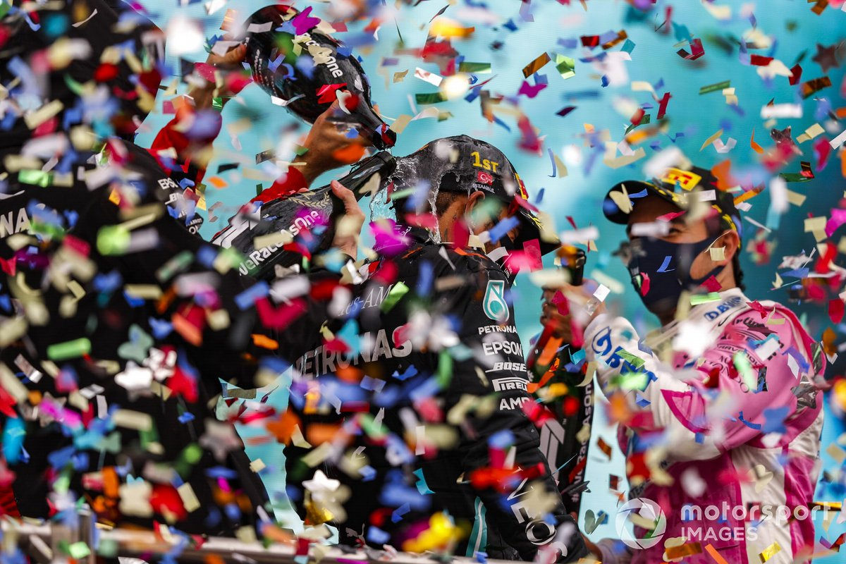 Sebastian Vettel, Ferrari, 3rd position, and Sergio Perez, Racing Point, 2nd position, pour Champagne over Lewis Hamilton, Mercedes-AMG F1, 1st position, on the podium