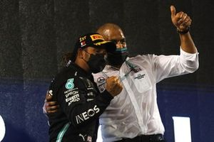 Lewis Hamilton, Mercedes, 1st position, celebrates with his team mate on the podium