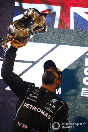 Lewis Hamilton, Mercedes, 1st position, with his trophy on the podium