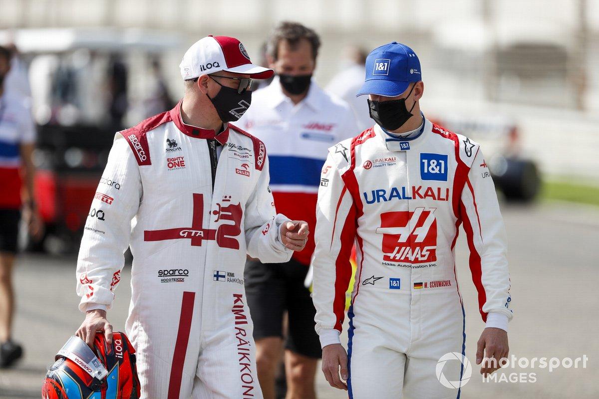 Kimi Raikkonen, Alfa Romeo and Mick Schumacher, Haas F1