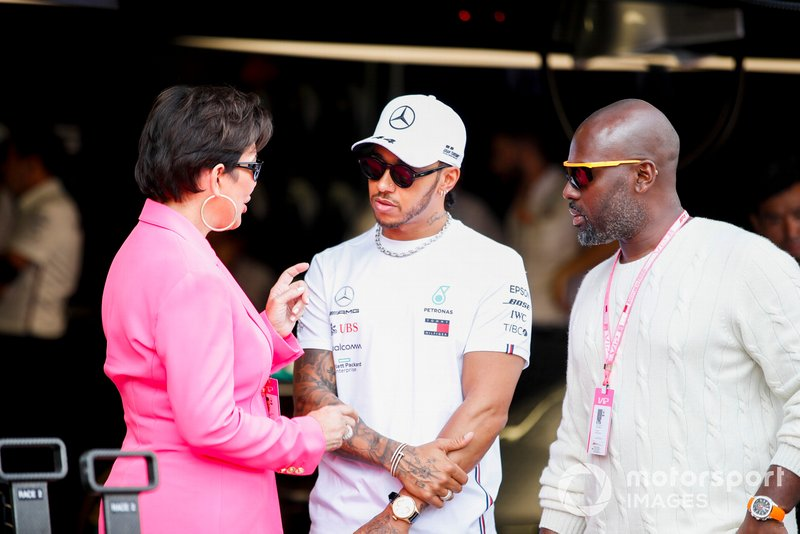 Kris Jenner and Corey Gamble talk with Lewis Hamilton, Mercedes AMG F1