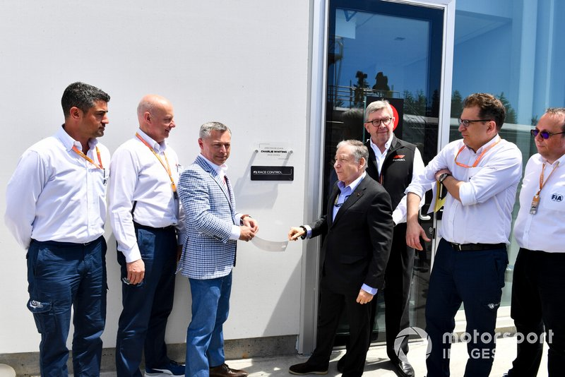 Francois Dumontier, President and CEO, Canadian Grand Prix, Jean Todt, President, FIA, and Ross Brawn, Managing Director of Motorsports, FOM, unveil a plaque dedicating a new Race Control building to the late Charlie Whiting, former FIA Race Director