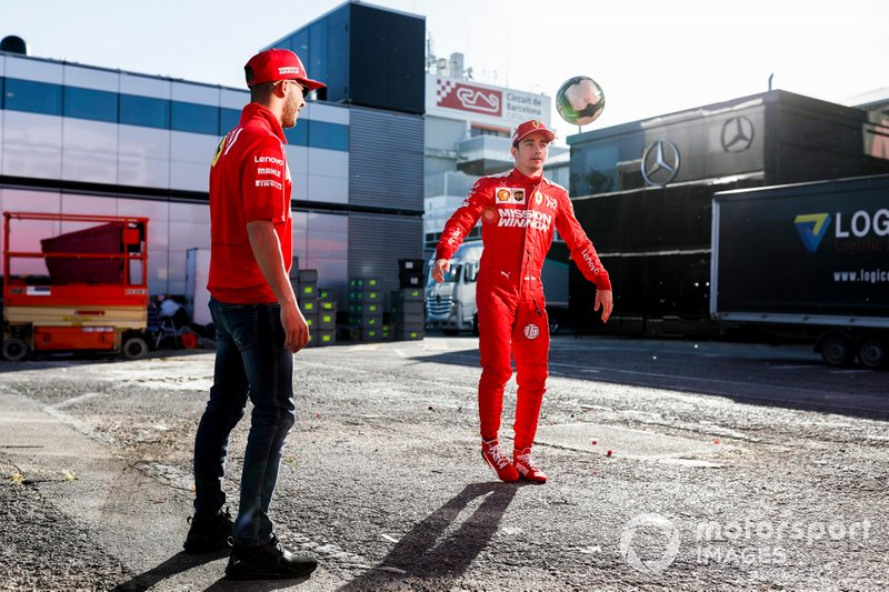 Charles Leclerc, Ferrari, plays football in the paddock with Antonio Fuoco, Ferrari