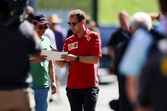 Sebastian Vettel, Ferrari signs a autograph for a fan