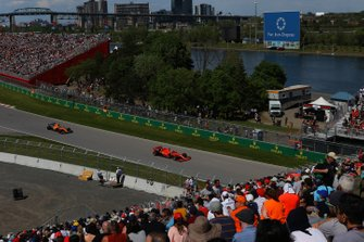 Sebastian Vettel, Ferrari SF90, leads Carlos Sainz Jr., McLaren MCL34
