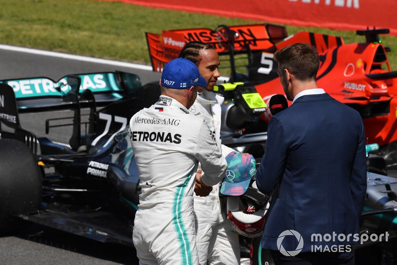 Pole man Valtteri Bottas, Mercedes AMG F1, and Lewis Hamilton, Mercedes AMG F1, are interviewed by Jenson Button, Sky Sports F1, after Qualifying