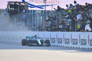 Valtteri Bottas, Mercedes AMG W10, 1st position, passes his team on the pit wall