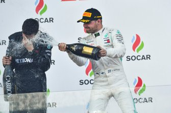 Valtteri Bottas, Mercedes AMG F1, 1st position, sprays his team mate with Champagne on the podium