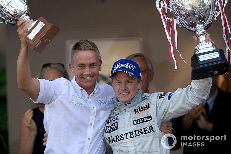 Podium: race winner Kimi Raikkonen, McLaren celebrates his victory with Martin Whitmarsh