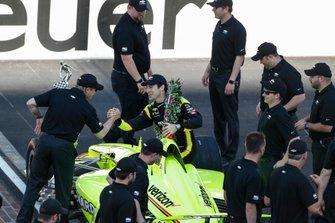 Simon Pagenaud, Team Penske Chevrolet poses for the winning driver photo shoot