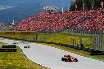 Charles Leclerc, Ferrari SF90, leads Valtteri Bottas, Mercedes AMG W10, and Lewis Hamilton, Mercedes AMG F1 W10
