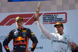 Race winner Max Verstappen, Red Bull Racing, and Valtteri Bottas, Mercedes AMG F1, 3rd position, with his trophy