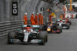 Lewis Hamilton, Mercedes AMG F1 W10, leads Max Verstappen, Red Bull Racing RB15, and Valtteri Bottas, Mercedes AMG W10