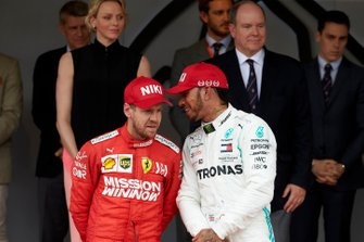 Sebastian Vettel, Ferrari, 2nd position, and Lewis Hamilton, Mercedes AMG F1, 1st position, talk on the podium