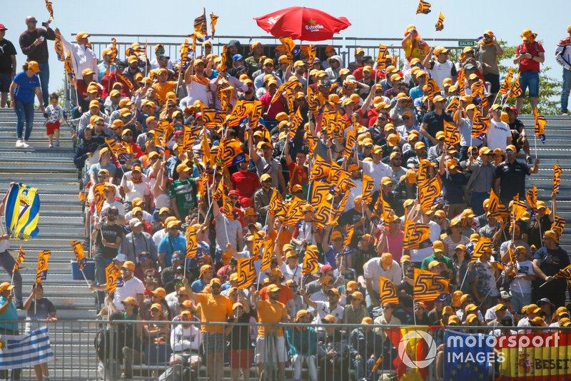 Fans of Carlos Sainz Jr., McLaren wave flags