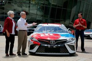 Dona and Gene Griffin, the parents of fallen U.S. Army Sgt. Dale Griffin, join defending Coca-Cola 600 winner Kyle Busch