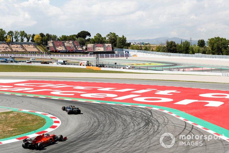 Kevin Magnussen, Haas F1 Team VF-19, Sebastian Vettel, Ferrari SF90