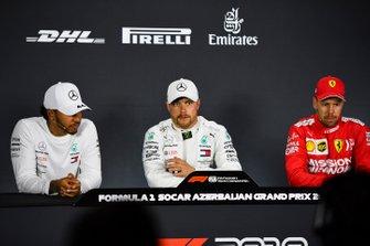 Polesitter Valtteri Bottas, Mercedes AMG F1, second place Lewis Hamilton, Mercedes AMG F1, third place Sebastian Vettel, Ferrari in the post-qualifying press conference